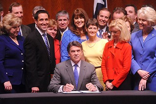 Gov. Rick Perry signs HB 2 into law