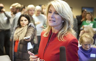 Gubernatorial candidate and state Sen. Wendy Davis talks to reporters Saturday during a stop at a campaign event at the Austin Bar Association.