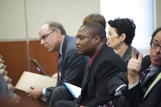 Anthony Graves sits amid attorneys at a Capitol hearing in 2011