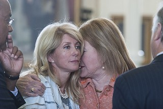 Sen. Sylvia Garcia offers a supportive hug to Sen. Wendy Davis during the Legislature's abortion debate.