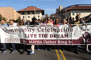 Former State Rep. Wilhelmina Delco (second from right) helps carry Austin Area Heritage Council's banner honoring the legacy of Martin Luther King Jr., on Monday. See <b><a href=http://austinchronicle.com/>austinchronicle.com</a> </b>for a photo gallery of MLK Day events.