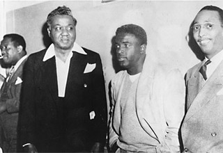 (l-r) Kenneth Lankins, Dr. E.H. Givens, Jackie Robinson, and the Rev. Karl Downs; date unknown