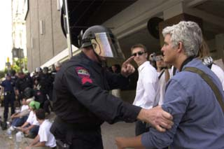 <i>Austin Chronicle</i> photographer Jana Birchum is manhandled by an Austin police officer at Monday's protest.
