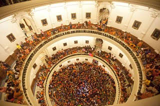 Opponents of HB 2 wear orange shirts inside the Capitol as Wendy Davis' June 2013 filibuster continued. Social media played a critical role in rallying advocates on both sides of the issue