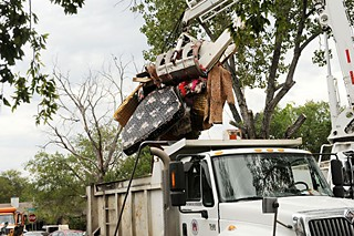 City crews clean up debris after the Onion Creek flooding.