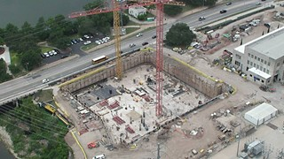 The construction site alongside Shoal Creek, facing Lady Bird Lake