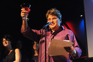 Madge Darlington of the Rude Mechanicals toasts the crowd in fitting Critics Table style during the company's induction into the Austin Arts Hall of Fame