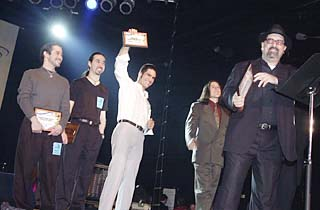 Del Castillo at the Austin Music Awards, March 12, with four of their six plaques <i>en mano</i>