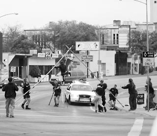 Last week eight protesters were arrested for setting up two tripods and a 25-foot banner reading, How many lives per gallon? at the intersection of Guadalupe and MLK. The group was arrested within minutes of launching its action, and charged with obstructing a roadway, a Class B misdemeanor. In dismantling the tripods -- manned by two female demonstrators -- APD did not use a net but  simply pulled the legs outwards, causing one demonstrator to fall. The officers did not call EMS to the scene, but cuffed the demonstrator and carted her away. The other demonstrator voluntarily dismounted her tripod in order to avoid injury.