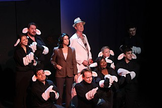 Sheep laughs: The chorus of Lambs surround Amy Downing as Clarice Starling and Huck Huckaby as Hannibal Lecter.