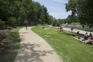 Improvements to Barton Springs Pool's south side, including this paved walkway to the pool, made their official debut Wednesday &#10;in a public celebration. For more images see <b><a href=http://austinchronicle.com/photos>austinchronicle.com/photos</a></b>.
