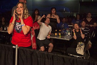 A boisterous crowd roots for their favorites in last Saturday's boxing tournament between firefighters and law enforcement officers. See <a href=/news/2014-07-18/firefighters-box-cops-for-charity/>Firefighters Box Cops for Charity</a>.
