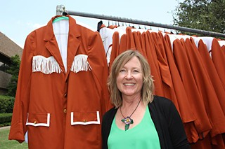 Costume designer Kari Perkins with meticulously re-created UT marching band costumes for the film <i>My All American</i>