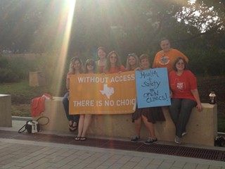 Pro-choice advocates protest outside the second suit against abortion-restrictive House Bill 2