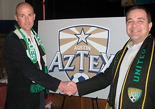 Dalglish (l) shakes hands with Aztex owner David Markley.