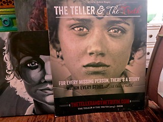 A poster for <i>The Teller &amp; the Truth</i> in Andrew Shapter's living room along with a painting of the image of lead actress Leilani Galvan.