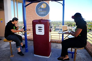 Erazo and Jackson use the SolarPump charging station installed outside the Dickey-Lawless Science Building