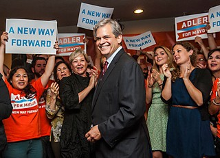 Surrounded by supporters at his campaign headquarters on Barton Springs Road, Austin mayoral candidate Steve Adler celebrates winning enough votes (37%) to head into a runoff with Council Member Mike Martinez (30%).  The two candidates will duke it out in December.