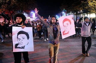 Protesters march in Austin last Tuesday, Nov. 25.