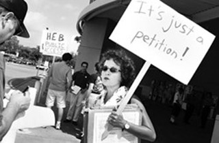 Linda Curtis protests outside of H-E-B in 2002.