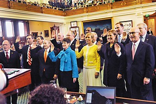 Members of the Texas Senate get sworn-in on Tuesday, Jan. 13,  the first day of the 84th Legislative session. Exiting Lieutenant Governor David Dewhurst relinquishes his post to presiding officer of the Senate, Lt. Gov. Dan Patrick, R-Houston (not pictured here).