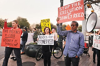 Protesters call for Reed's exoneration at a January rally.