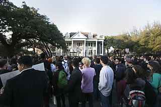 Protesters gather in front of the Fiji house on Feb. 12