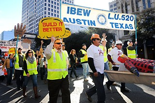 Protesters rally Feb. 25 to commemorate hundreds of Texas construction workers killed on the job during the Day of the Fallen event hosted by the Workers Defense Project since 2011. Demonstrators called on Texas lawmakers to provide safe working conditions and fair pay for laborers.