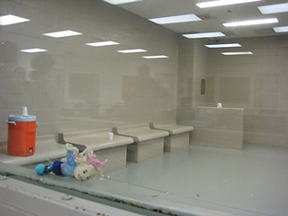 A Border Patrol detention cell for children in Brownsville, Texas. These cells are often referred to as iceboxes because they are kept at a low temperature. No blankets are available.