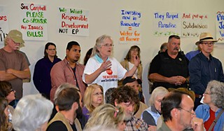 Citizens protest the groundwater well project during a Feb. 10 town hall meeting, hosted by state Rep. Jason Isaac.