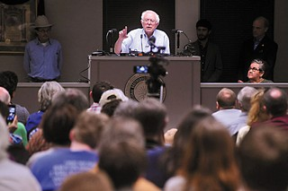 Flanked by columnist Jim Hightower and District 4 City Council Member Greg Casar, U.S. Senator Bernie Sanders, I-Vermont, called for economic justice and Wall Street reforms during a town hall meeting at IBEW Local 520 Union on March 31. The self-described democratic socialist is currently mulling a 2016 presidential run.