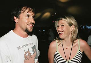 Reunited, and it feels so good: <i>Dazed and Confused </i>director Richard Linklater and cast member Joey Lauren Adams at the movie's 10th anniversary screening/lake party