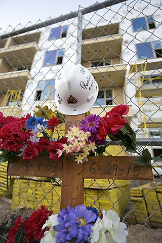 A memorial for Ramiro Loa in front of the Eastside Station Apartments