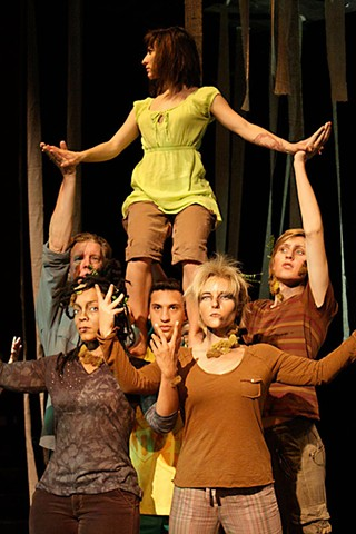 Safe among the branches: April Perez Moore (center) and cast members of <i>The Tree Play</i>