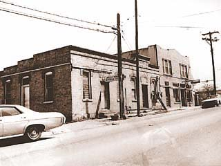 The building at 1010 E. 11th, shown here as it appeared in the Seventies, is more than 111 years old and is now one of the oldest commercial buildings on the Eastside. The Southern Dinette (far right) closed in 1988, and all but the west section of the structure (now Shoehorn Design) burned down three years later.<br>