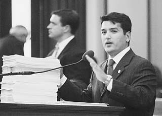 State Rep. Mike Villarreal, D-San Antonio, makes the case against the redistricting bill before the Texas House of Representatives on Monday. The taller stack of papers before Villareal contains witness statements presented to the House Redistricting Committee against redistricting; the shorter stack contains statements supporting the bill. In keeping with the theme of the session, House Republicans ignored public sentiment and pushed the bill through to the Senate.
