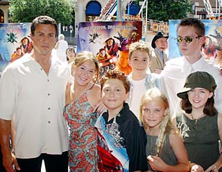 The cast of <i>Spy Kids 3-D: Game Over</i> gathered at downtown's historic Paramount Theatre on Sunday, July 13, to celebrate the world premiere of the franchise's third outing. Sylvester Stallone (l) -- who plays the film's big baddie, the Toymaker -- almost cracks a smile here in front of the Congress Avenue carnival with the young cast, including the series' stars Alexa Vega (second from left) and Daryl Sabara (third from left).