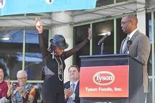 Lola Stephens-Bell, also known as the Nubian Queen, is honored for her long-term volunteer efforts to feed the hungry with an official City of Austin Day from Kazique Jelani Prince of the Mayor's office, and the gift from Tyson Foods of a truckload of food and a new van to deliver it in. Jan. 15, 2016.