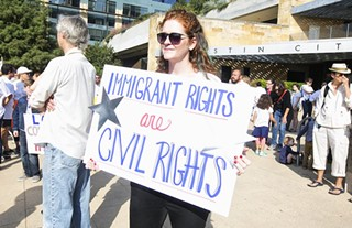 Protesters gathered outside of City Hall in support of immigration rights in November