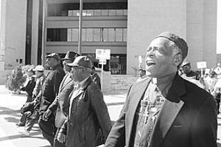 Ministers from the Baptist Ministers Union of Austin and members of their congregations marched from Austin Police Headquarters to City Hall in protest of the recent actions of the APD.
