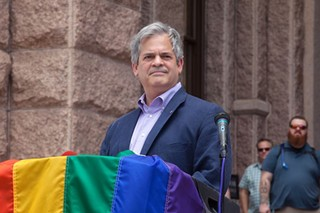 Adler speaks at an Equality March in June