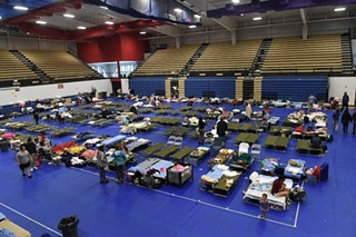 Evacuees at the Delco Center on Sunday