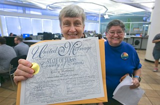 A Travis County couple picks up their marriage license on July 4, 2015 following the legalization of same-sex marriage by the U.S. Supreme Court.