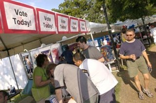 The Lesbian/Gay Rights Lobby of Texas held a mock election at the Gay Pride Festival on Sunday. Only registered voters were allowed to participate. The Stonewall Democrats, in the neighboring booth, were on hand to register voters.