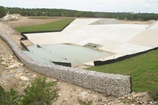 Concrete dam, with detention pond above right, and secondary rock  filter below dam where water enters Lick Creek stream bed