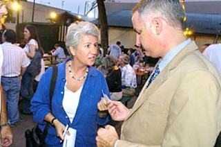 Former Austin City Council Member  Brigid Shea ponies up a check for Richard Morrison, challenger to Tom DeLay.