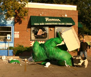 Alas, the Guadalupe Mangia dinosaur – affectionately known as Godzilla – is no more, or at least will spend hard time in intensive care. Vandals apparently knocked the giant from his rooftop perch early Tuesday morning, and the luckless behemoth landed on his head, shattering it into many