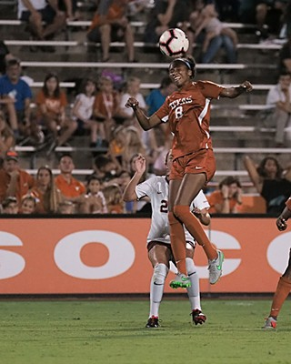 Alexa Adams skies for a header