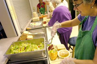 Volunteers preparing meals at Caritas