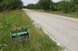 This sign on Hamilton Pool Road calls for the LCRA 
